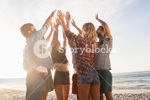 Happy friends giving high five