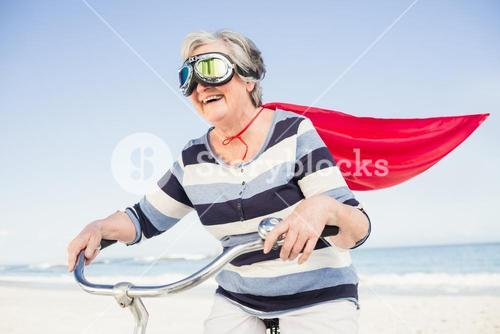 Senior superwoman on a bike