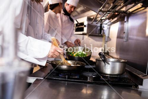 Group of chef preparing food in the kitchen