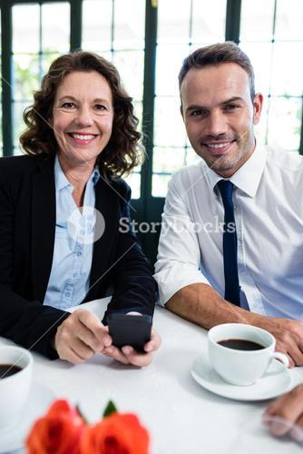Portrait of business colleagues with mobile phone