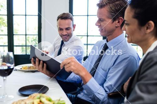 Business colleagues looking at a file and discussing