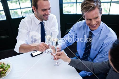 Businessmen toasting with champagne