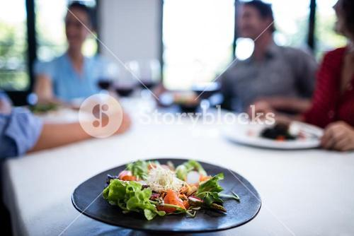 Plate of salad on the restaurant table