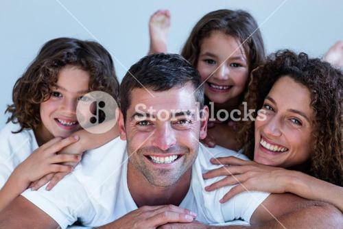 Portrait of a family lying on bed