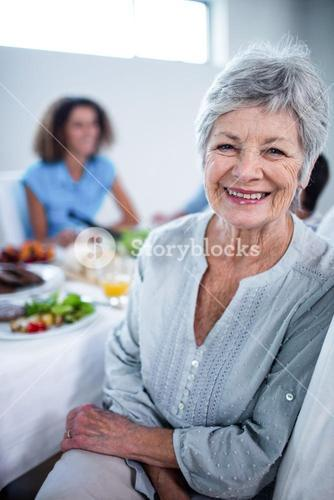 Portrait of senior woman sitting at dinning table