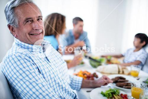 Portrait of senior man sitting at dinning table