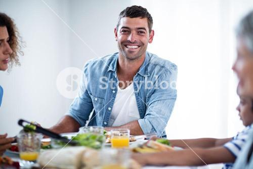 Man having breakfast with family