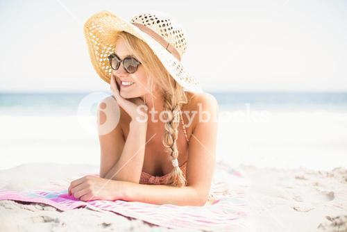 Happy woman lying on the beach
