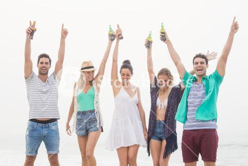 Group of friends holding beer bottle