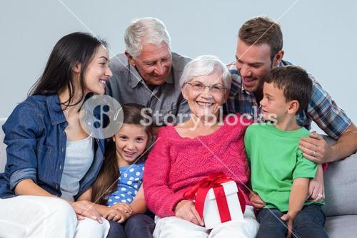 Family giving a gift to grandmother