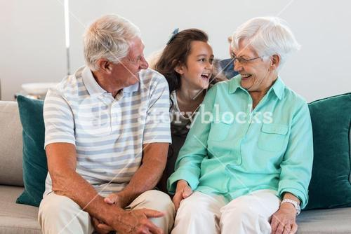Grandmother and grand father with their granddaughter