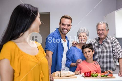 Happy family standing in the kitchen