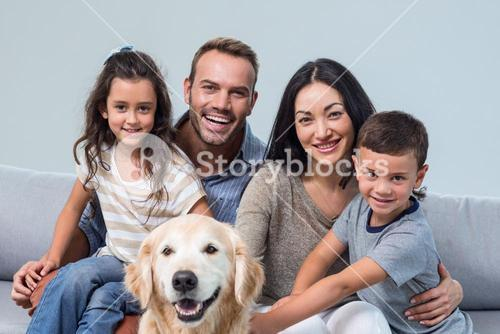Family with dog in living room