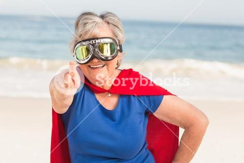 Senior woman wearing superwoman custome