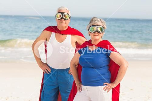 Senior couple wearing superman costume