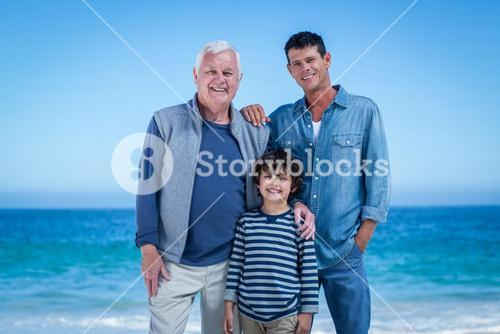 Male family members posing at the beach