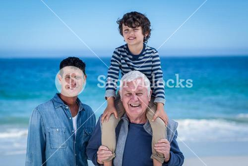 Male family members playing at the beach