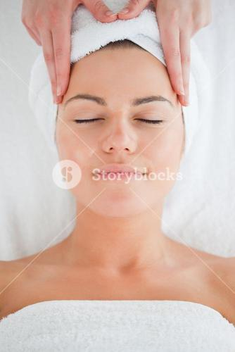 Portrait of a cute woman having a facial massage