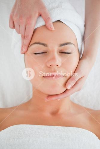 Portrait of a woman enjoying a facial massage