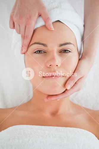 Portrait of a cute woman enjoying a facial massage