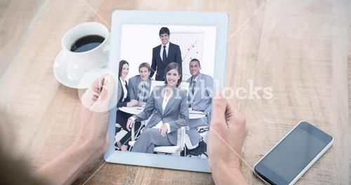 Composite image of woman using tablet computer at table