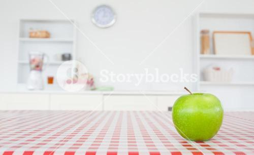 An apple on a tablecloth