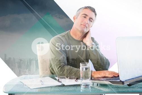 Composite image of businessman with neck pain using laptop at desk