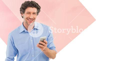 Composite image of businessman holding mobile phone over white background