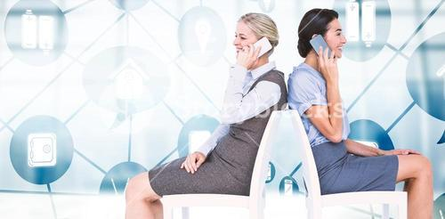 Composite image of businesswomen using smartphones while sitting on chair