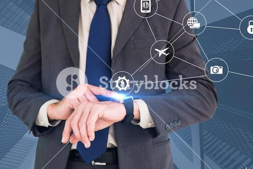 Composite image of businessman looking at watch