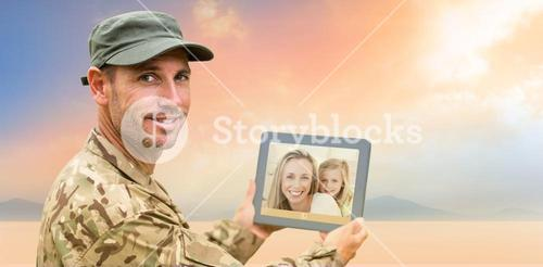 Composite image of soldier using tablet pc