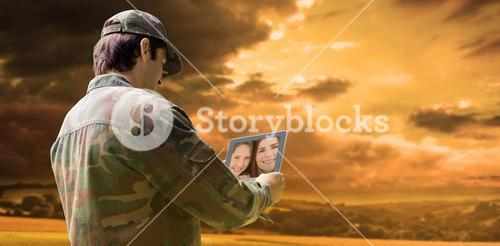 Composite image of army officer using tablet