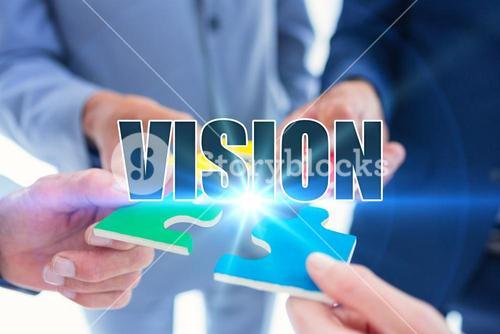 Vision against business colleagues holding piece of puzzle