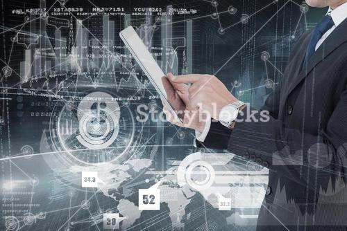 Composite image of businessman in suit using digital tablet