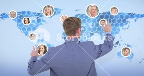 Composite image of back turned businessman gesturing with hands