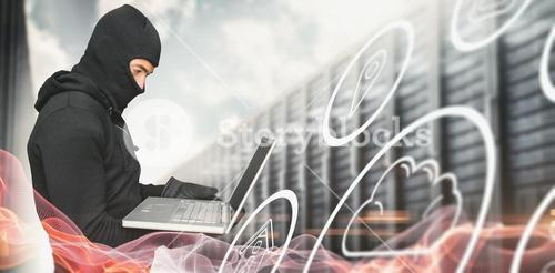 Composite image of side view of hacker using laptop