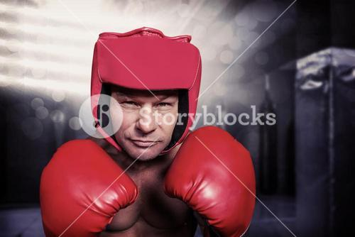 Composite image of portrait of boxer with gloves and headgear