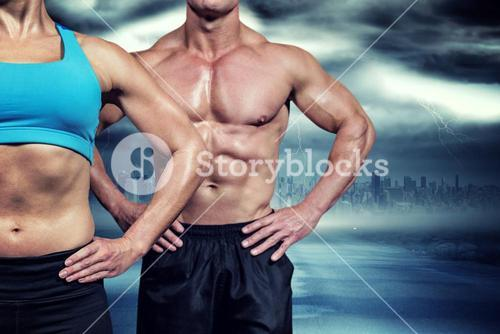 Composite image of midsection of muscular woman and man standing with hands on hip