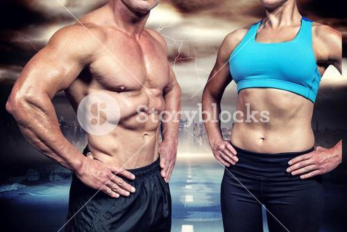 Composite image of midsection of muscular man and woman with hands on hip