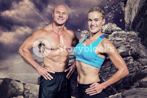 Composite image of portrait of happy man and woman with hand on hip