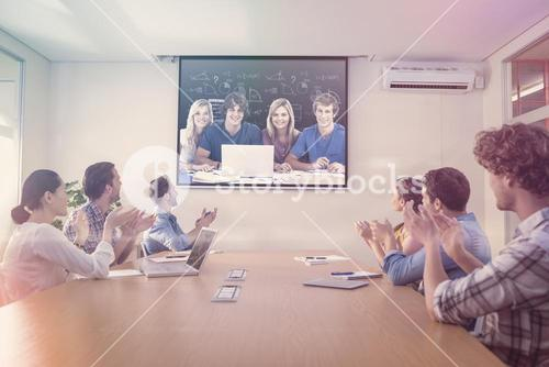 Composite image of a group of students with a laptop look into the camera