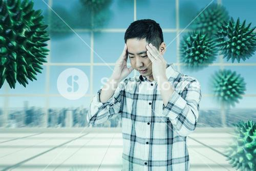 Composite image of asian man getting a headache
