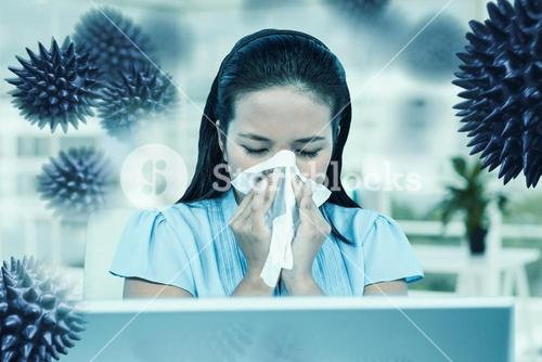 Composite image of businesswoman blowing her nose