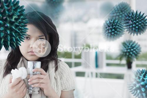 Composite image of sick woman holding a tissue and a glass of water