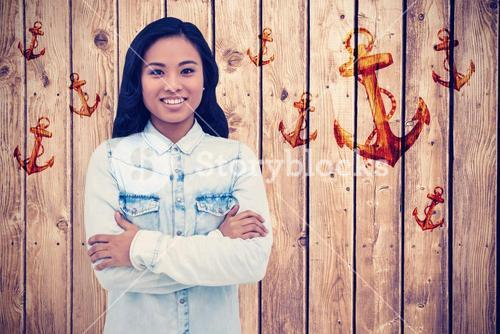 Composite image of asian woman with arms crossed smiling