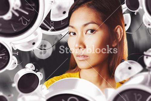 Composite image of serious asian woman with hands on shoulders