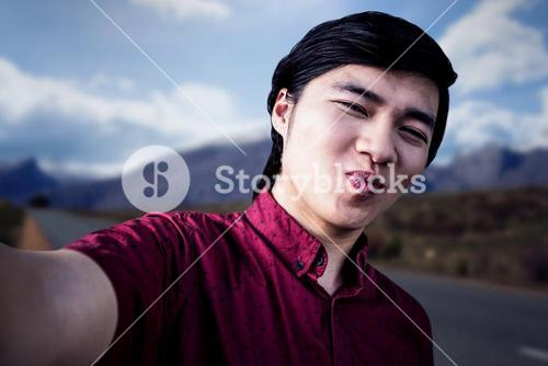Composite image of hipster man taking a selfie