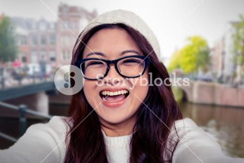 Composite image of asian woman smiling at the camera