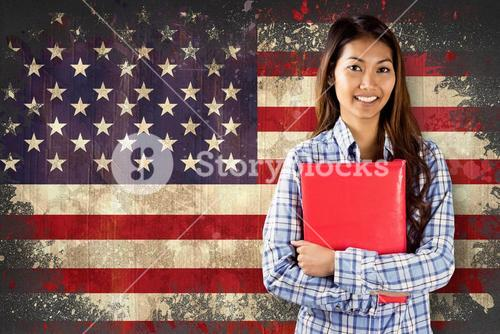 Composite image of smiling asian woman holding red book