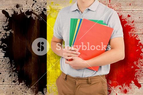 Composite image of mid section of man holding files